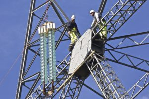 New insulators lifted into position